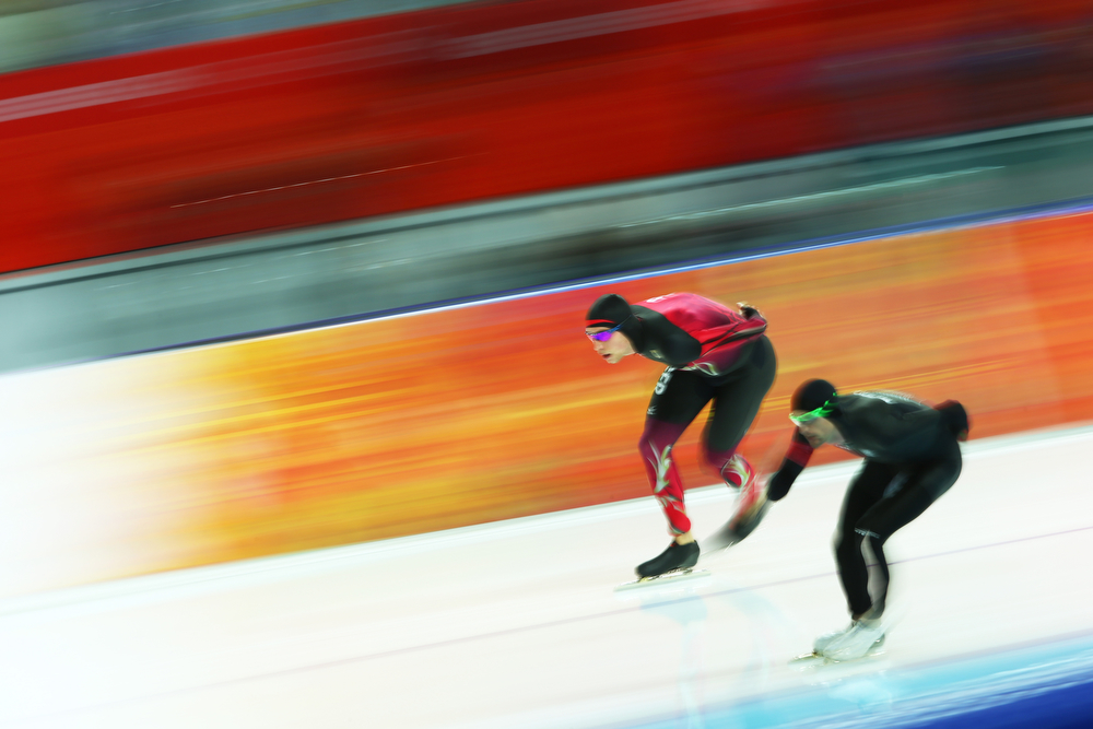 . Moritz Geisreiter (L) of Germany and Shane Dobbin of New Zealand compete during the Men\'s 10000m Speed Skating event on day eleven of the Sochi 2014 Winter Olympics at Adler Arena Skating Center on February 18, 2014 in Sochi, Russia.  (Photo by Paul Gilham/Getty Images)