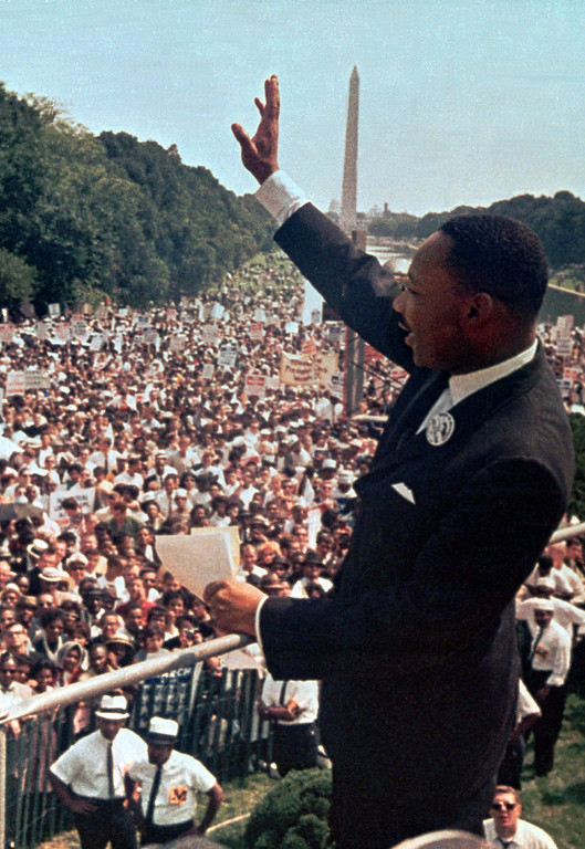 ". In this Aug. 28, 1963 file photo, The Rev. Martin Luther King Jr. waves to the crowd at the Lincoln Memorial for his ""I Have a Dream\"" speech during the March on Washington. The march was organized to support proposed civil rights legislation and end segregation. (AP Photo/File)"