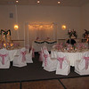 Rose Pink Wedding- Decorated Head Table, Backdrop and Lighted Cake Table.  The tablecovers and chairs are white with pink organza sashes.  Maneeley's in South Windsor, CT