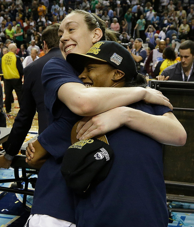 . Connecticut forward Breanna Stewart (30) hugs a team mate after the second half of the championship game against Notre Dame in the Final Four of the NCAA women\'s college basketball tournament, Tuesday, April 8, 2014, in Nashville, Tenn. Connecticut won 79-58. (AP Photo/Mark Humphrey)