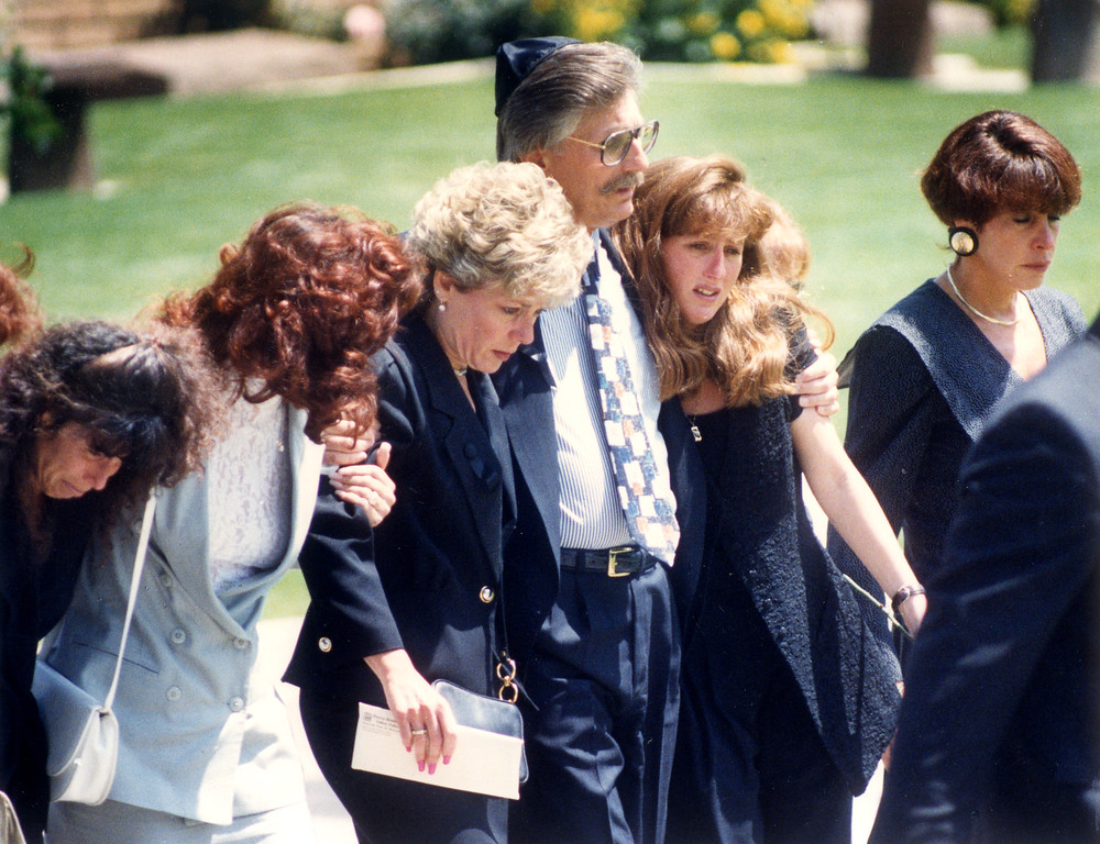 . Left to right are Ronald Goldman\'s stepmother Patti, his father, Fred and his sister, Kim, walk to his grave site.   (6/16/94)  (Los Angeles Daily News file photo)
