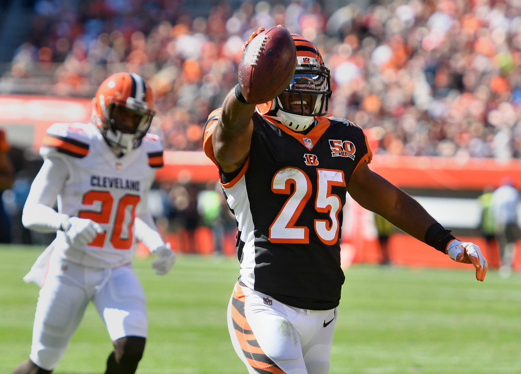 . Cincinnati Bengals running back Giovani Bernard (25) celebrates after a 61-yard touchdown in the first half of an NFL football game against the Cleveland Browns, Sunday, Oct. 1, 2017, in Cleveland. (AP Photo/David Richard)
