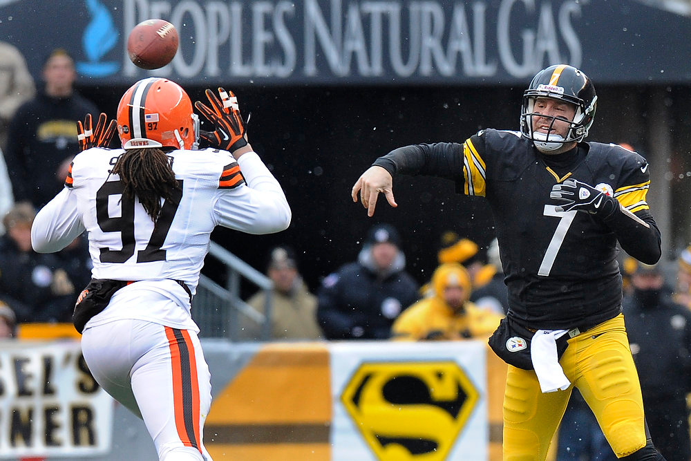 Description of . Pittsburgh Steelers quarterback Ben Roethlisberger (7) passes over Cleveland Browns defensive end Jabaal Sheard (97) in the first quarter of an NFL football game on Sunday, Dec. 30, 2012, in Pittsburgh. (AP Photo/Don Wright)