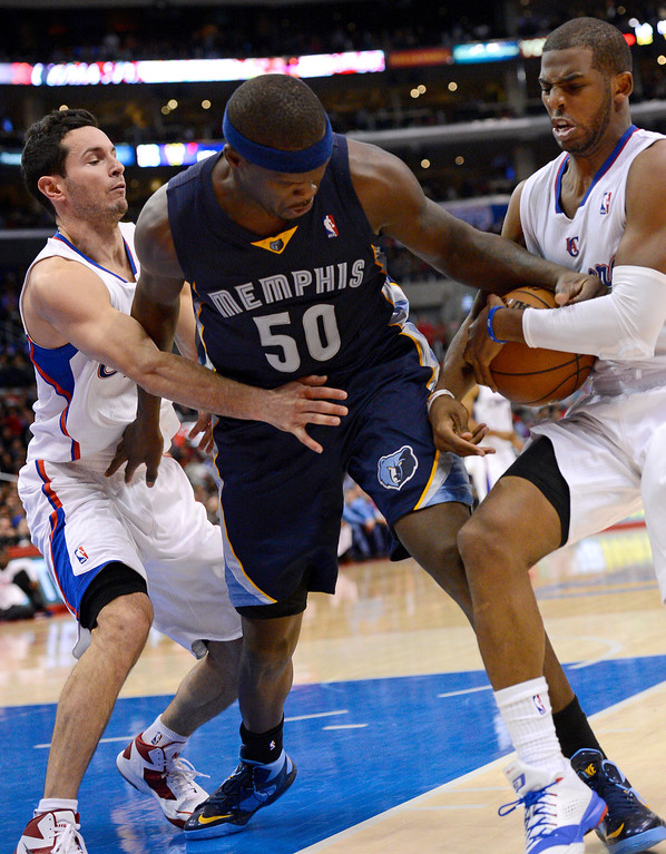 . Los Angeles Clippers\' Chris Paul and J.J. Redick compete for the ball with Zach Randolph of the Memphis Grizzlies during the second half Monday, Nov. 18, 2013, in Los Angeles.  The Clippers lost the game 106-102.(Andy Holzman/Los Angeles Daily News)