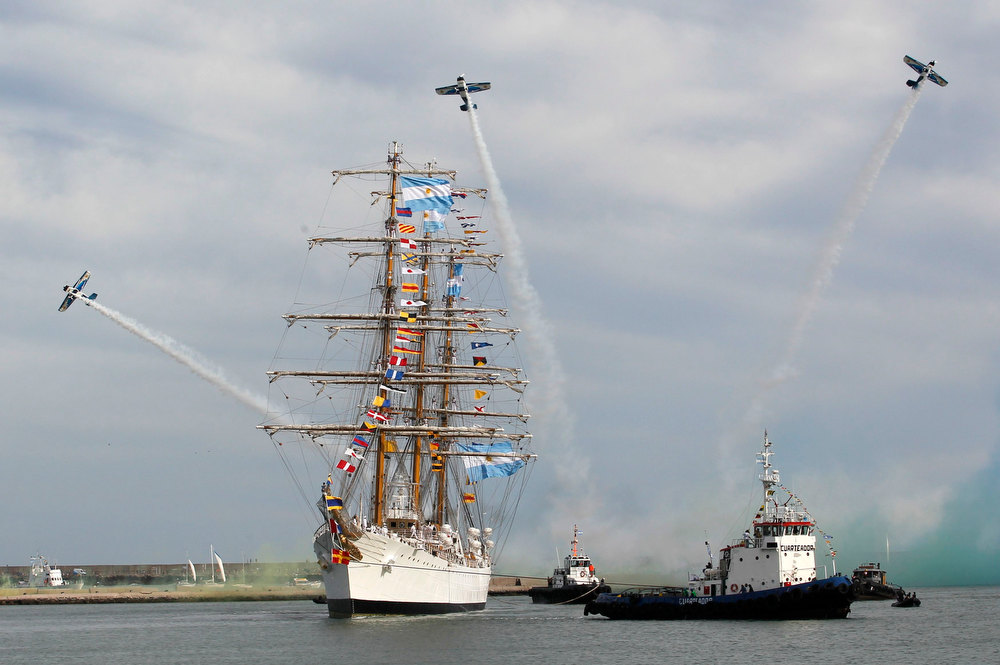 Description of . Acrobatic aircrafts perform as Argentine navy vessel ARA Libertad arrives at the harbor of the seaside resort of Mar del Plata January 9, 2013. The tall sailing ship used for training was detained in Ghana since October 2, 2012 at the request of a hedge fund seeking payment on defaulted government bonds. It was later released and left Ghana on December 19, 2012 for Mar del Plata following a ruling by the International Tribunal for the Law of the Sea that Ghana should release the ship after Argentina argued that a U.N. Convention on the law gives warships immunity from civil claims when they dock at foreign ports. REUTERS/Enrique Marcarian