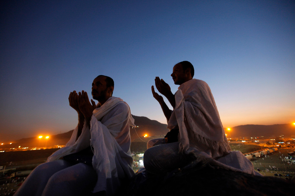 . Muslim pilgrims pray on a rocky hill called the Mountain of Mercy, near the holy city of Mecca, Saudi Arabia, Monday, Oct. 14, 2013. Joined by their faith and a desire to purify their souls, more than 2 million Muslims from nearly 200 countries gathered around a hill in Saudi Arabia on Monday marked by a small white pillar. It is here, in Mount Arafat on the Mountain of Mercy, known in Arabic as Jabal al-Rahma, that the Prophet Muhammad is believed to have delivered his last sermon to tens of thousands of followers, calling on Muslims to unite.(AP Photo/Amr Nabil)
