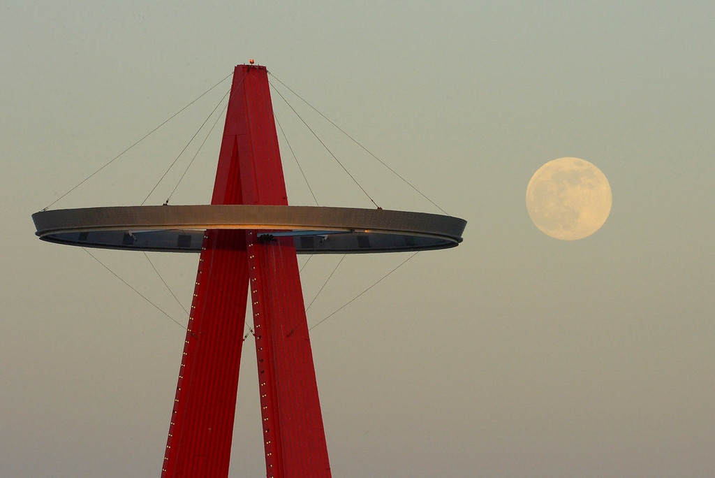 ". The moon rises next to the Los Angeles Angels\' ""Big A\"" sign during their baseball game against the Pittsburgh Pirates on Saturday, June 22, 2013, in Anaheim, California.  (AP Photo/Mark J. Terrill)"