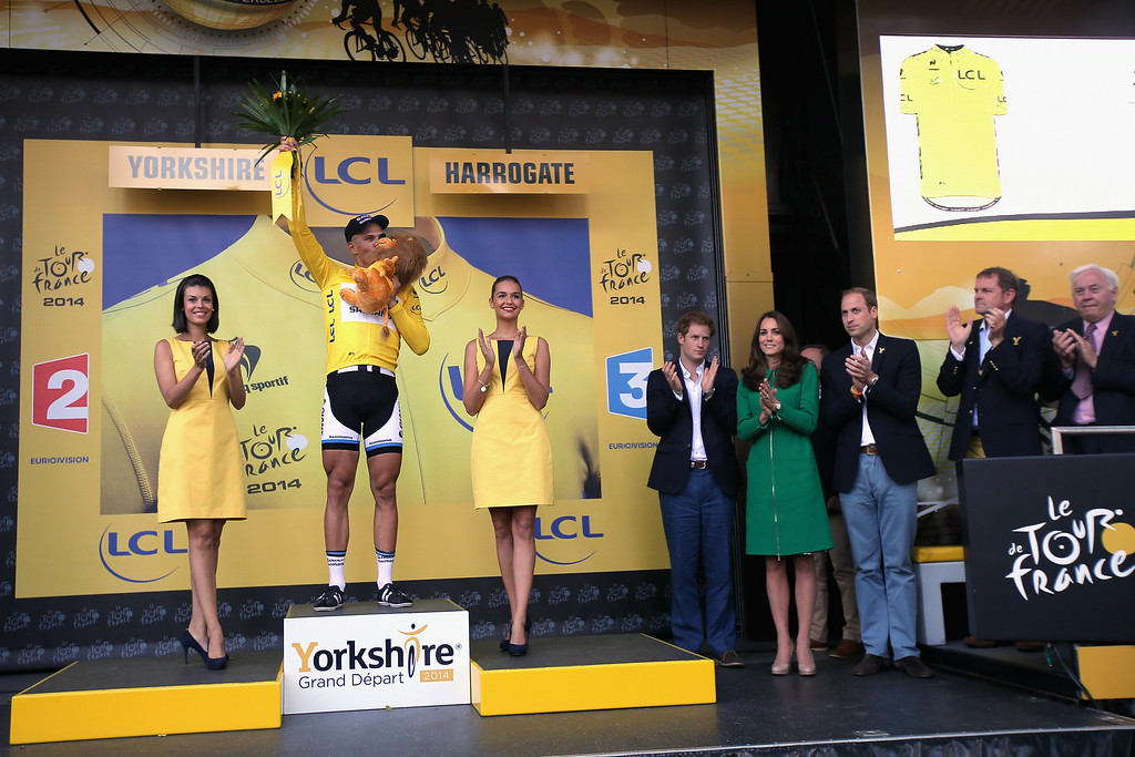 . HARROGATE, ENGLAND - JULY 05:  Overall race leader Marcel Kittel of Germany and Team Giant-Shimano is presented takes the podium as Prince Harry, Catherine, Duchess of Cambridge and Prince William, Duke of Cambridge observe after Kittel won stage one of the 2014 Tour de France from Leeds to Harrogate on July 5, 2014 in Harrogate, United Kingdom.  (Photo by Doug Pensinger/Getty Images)