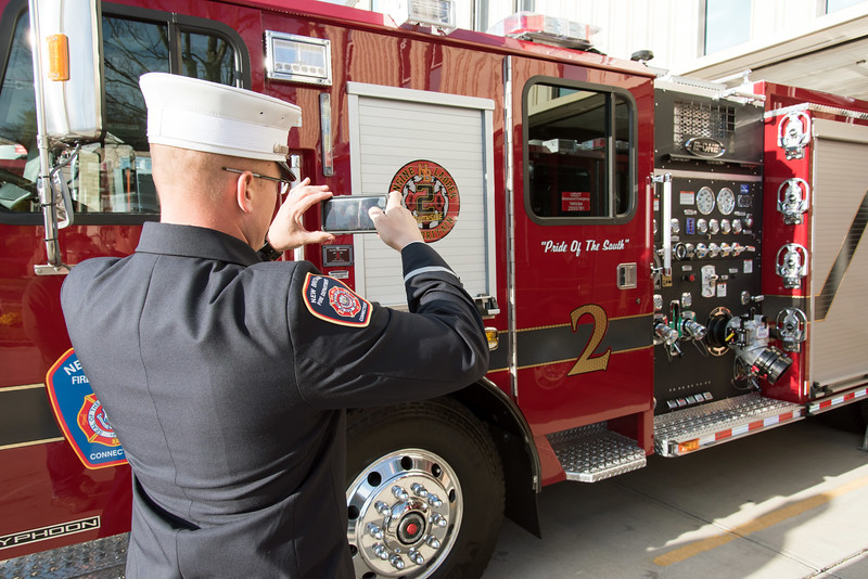 11/14/18  Wesley Bunnell | Staff  The New Britain Fire Department unveiled three new fire trucks on Wednesday afternoon during a ceremony at their Beaver St headquarters.  Lt. Shane Burns takes a photo of Engine 2.