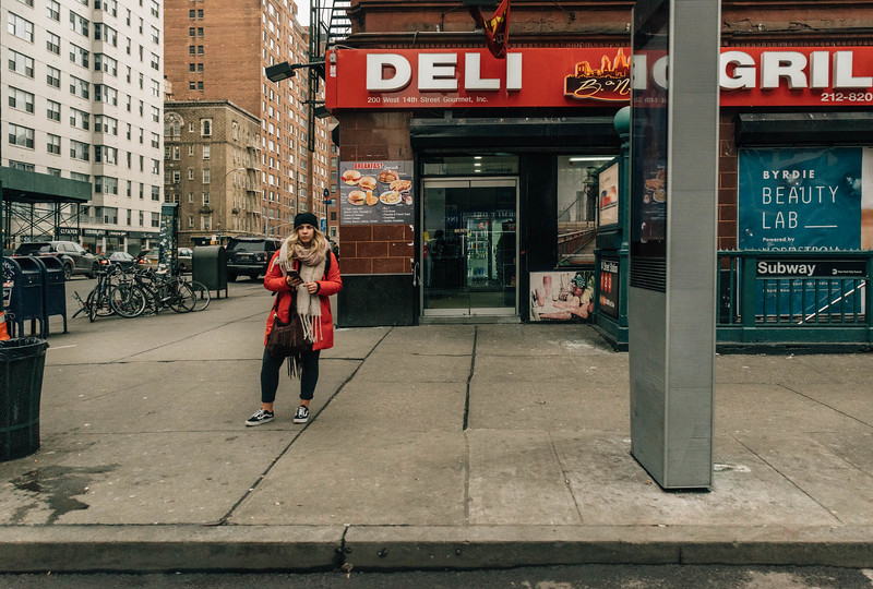 Red coat girl at deli.jpg