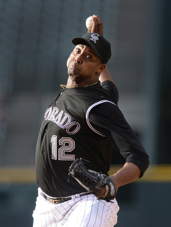 . Rockies starter Juan Nicasio pitched in the first inning. Nicasio allowed seven runs including a grand-slam home run by Andrelton Simmons. The Colorado Rockies hosted the Atlanta Braves Tuesday night, June 10, 2014. (Photo by Karl Gehring/The Denver Post)