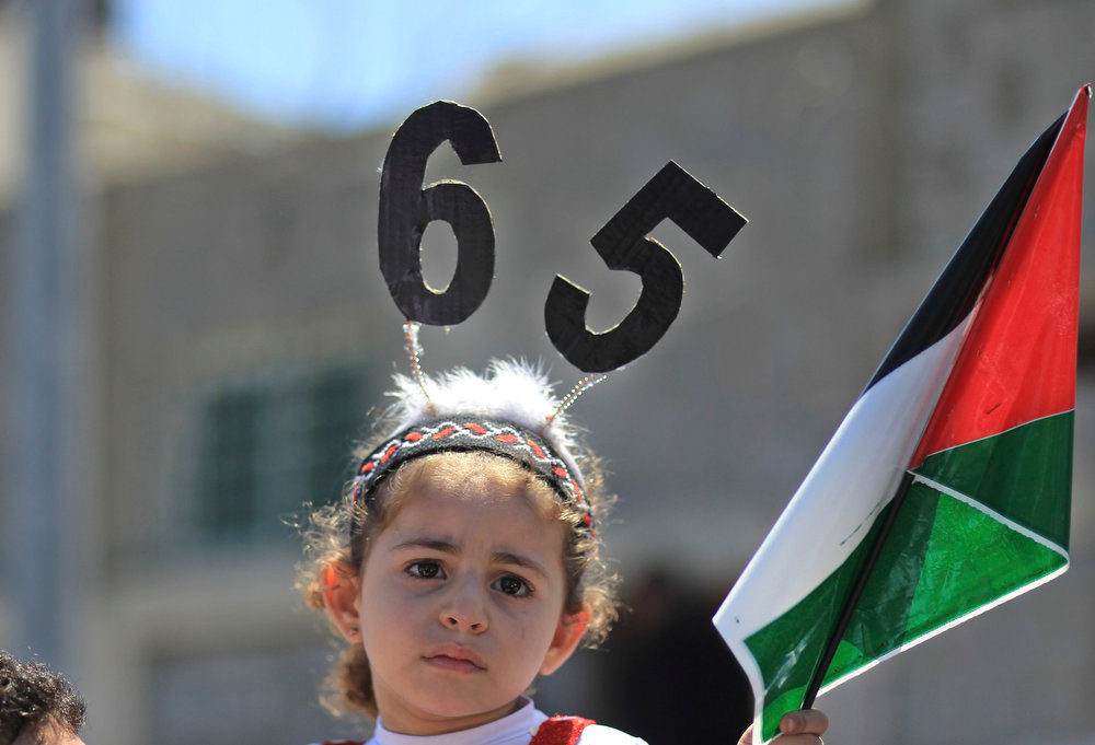 ". A Palestinian girl attends a Nakba rally in Gaza City May 15, 2013. Palestinians will mark ""Nakba\"" (Catastrophe) on May 15 to commemorate the expulsion or fleeing of some 700,000 Palestinians from their homes in the war that led to the founding of Israel in 1948.  REUTERS/Mohammed Salem"