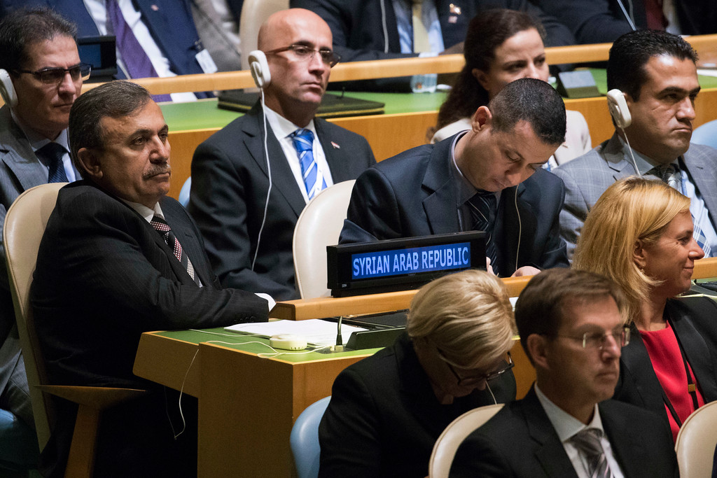 . Members of the Syrian delegation listen as U.S. President Donald Trump speaks during the 72nd session of the United Nations General Assembly at U.N. headquarters, Tuesday, Sept. 19, 2017. (AP Photo/Mary Altaffer)