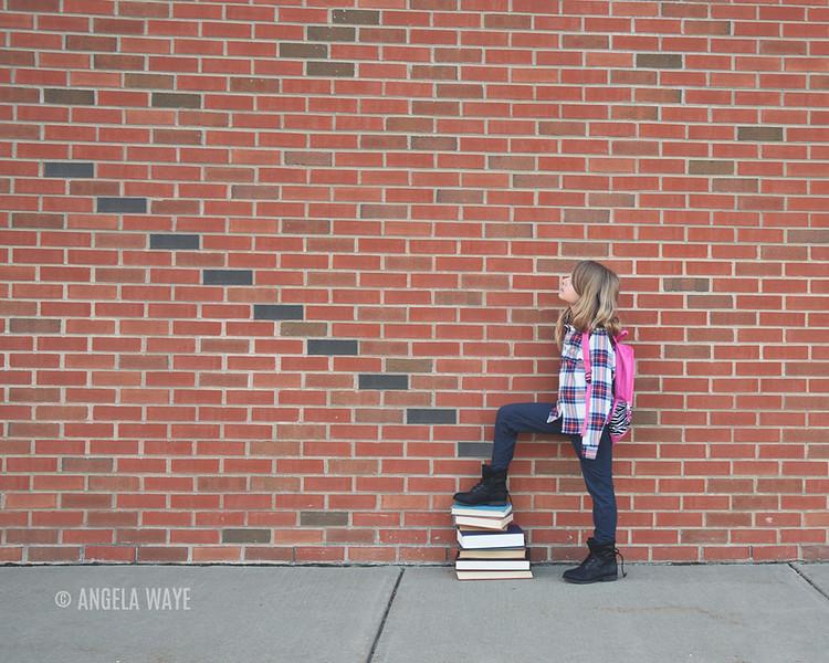 School Child Looking at Brick Steps