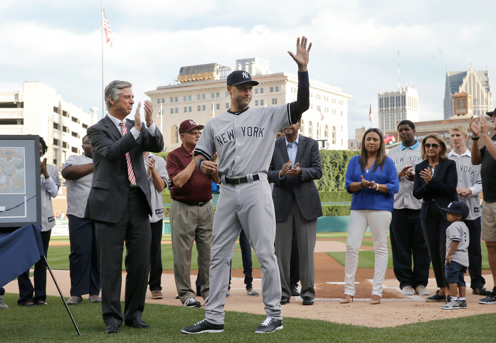 . New York Yankees shortstop Derek Jeter acknowledges the crowd in a special on-field ceremony before a baseball game against the Detroit Tigers in Detroit Wednesday, Aug. 27, 2014. (AP Photo/Paul Sancya)