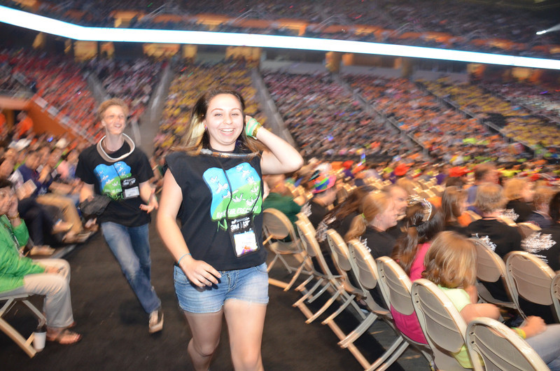 Members of Lebanon High School, The Central New Hampshire Improv Troupe head down from their seats as they are announced as winning the First Place in the World, Improvisational Challenge at Destination Imagination Global Finals