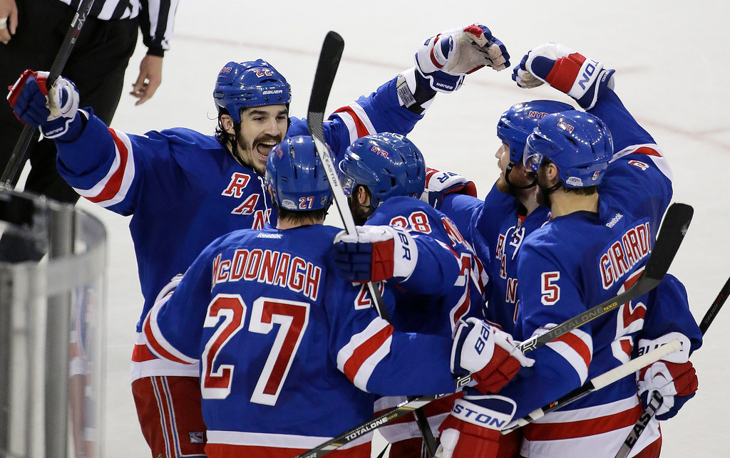 . New York Rangers center Brian Boyle (22) celebrates with teammates after center Dominic Moore (28) scored a goal against the Montreal Canadiens during the second period in Game 6 of the NHL hockey Stanley Cup playoffs Eastern Conference finals, Thursday, May 29, 2014, in New York. (AP Photo/Frank Franklin II)