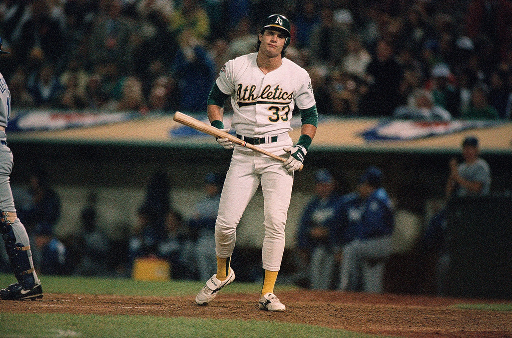 . Oakland A\'s Jose Canseco heads back to the dugout after striking out with a man on first in the bottom of the ninth inning of the fourth game of the World Series against the Los Angeles Dodgers, Wednesday, Oct. 19, 1988 in Oakland. Canseco was held hitless in the game as the A\'s went down to defeat, 4-3, and they now trail the series, 3-1. (AP Photo/Lenny Ignelzi)