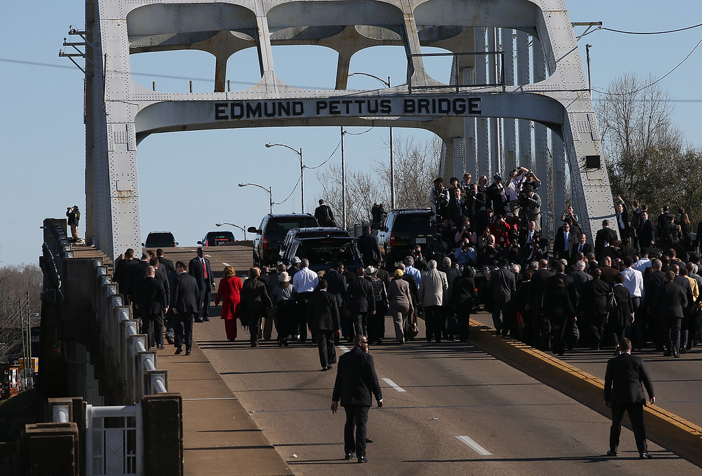 . U.S. President Barack Obama leads a delegation across the Edmund Pettus Bridge during a commemoration of the 50th anniversary of the historic civil rights march on March 7, 2015 in Selma, Alabama. Selma is commemorating the 50th anniversary of the famed civil rights march from Selma to Montgomery that resulted in a violent confrontation with Selma police and State Troopers on the Edmund Pettus Bridge on March 7, 1965.  (Photo by Justin Sullivan/Getty Images)