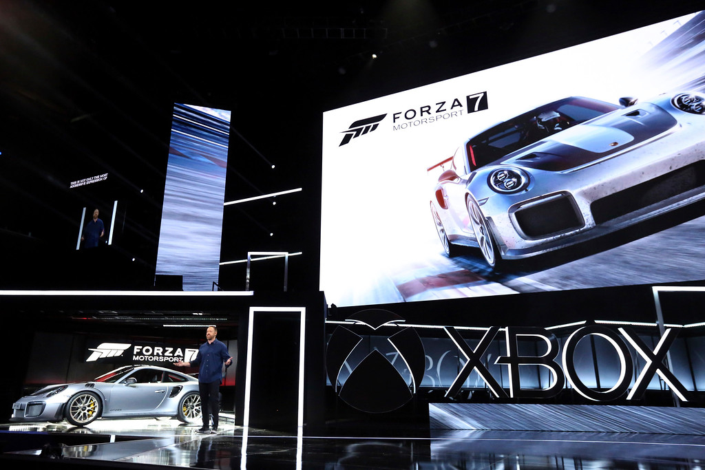 ". IMAGE DISTRIBUTED FOR MICROSOFT - Dan Greenawalt, Creative Director, Turn 10 Studios, unveils ""Forza Motorsport 7\"" in 4K and the 2018 Porsche 911 GT2 RS at the Xbox E3 2017 Briefing on Sunday, June 11, 2017 in Los Angeles. (Photo by Casey Rodgers/Invision for Microsoft/AP Images)"
