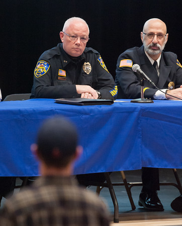 03/19/18 Wesley Bunnell   Staff Berlin held a school security safety meeting on Monday night at Berlin High School which was open to the public. Representatives from the town, police and fire departments gave an overview of their current responsibilities as well as planned changes while later answering questions from the audience. Police Chief John Klett and Deputy Fire Marshal/Director of Emergency Management Matt Odishoo listen to concerns from an audience member.