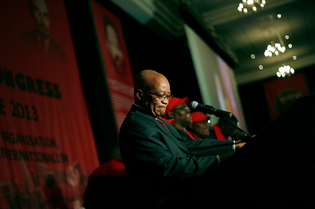 """. South African President Jacob Zuma addresses the 10th annual meeting of the National Education Health & Allied Workers in Johannesburg, Wednesday June 26, 2013. During his speech, Zuma said Nelson Mandela was \""""still critical\"""" and that we must \""""pray every minute\"""". (AP Photo/Jerome Delay)"""