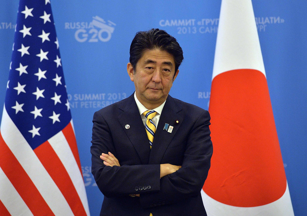 . Japans Prime Minister Shinzo Abe waits for US President to arrive for a bilateral meeting on the sideline of the G20 summit in Saint Petersburg on September 5, 2013.  AFP Photo/Jewel SAMAD/AFP/Getty Images