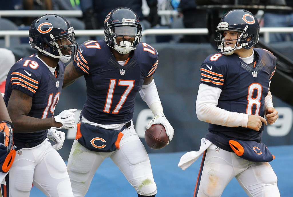. Chicago Bears receiver Alshon Jeffery (17) celebrates a touchdown reception with receiver Josh Morgan (19) and quarterback Jimmy Clausen (8) in the second half of an NFL football game against the Detroit Lions Sunday, Dec. 21, 2014, in Chicago. (AP Photo/Nam Y. Huh)