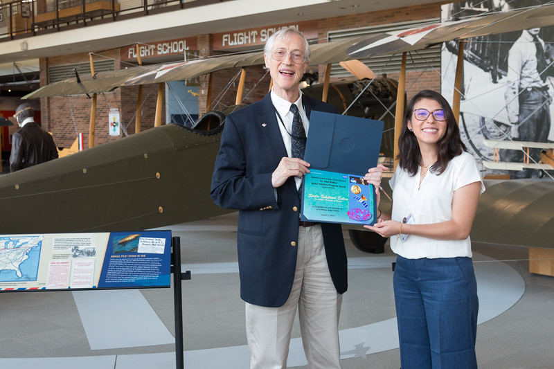 "Stela Ishitani Silva with John Mather, in front of Curtiss Jenny JN-4 -- An award luncheon, ""Dr. John Mather Nobel Scholars Program Award"", as part of the National Space Grant Foundation. College Park Aviation Museum, College Park, MD, August 2, 2019."