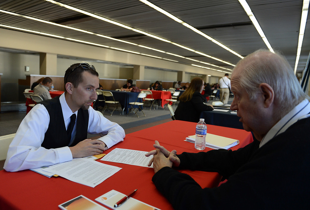 . Ron Ellenburg, of Rancho Cucamonga, left, gets help with his resume from Volunteer John Landaker, of Upland, during the San Bernardino County Workforce Investment Board\'s West End Spring Job Fair Wednesday, April 17, 2013, at LA/Ontario International Airport in Ontario. Jennifer Cappuccio Maher/Staff Photographer