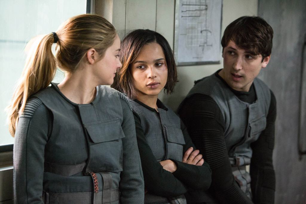 """. This image released by Summit Entertainment shows, from left, Shailene Woodley, Zoe Kravitz, and Ben Lloyd-Hughes in a scene from \""""Divergent.\"""" (AP Photo/Summit Entertainment, Jaap Buitendijk)"""