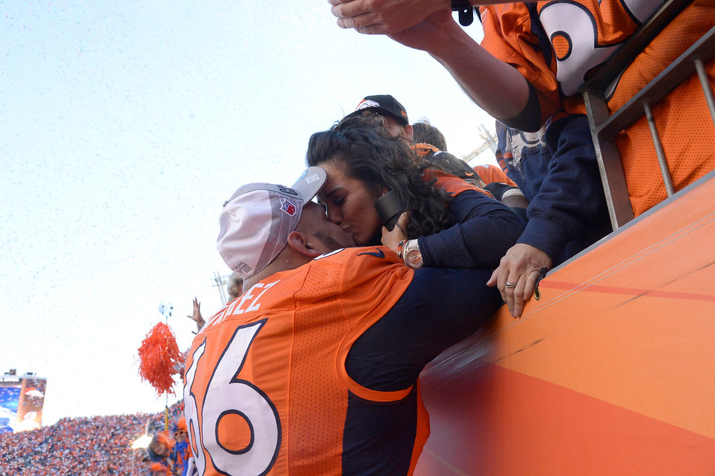. Denver Broncos center Manny Ramirez (66) gets a kiss from his wife after the Denver Broncos beat the New England Patriots 26-16. The Denver Broncos vs. The New England Patriots in an AFC Championship game  at Sports Authority Field at Mile High in Denver on January 19, 2014. (Photo by Joe Amon/The Denver Post)