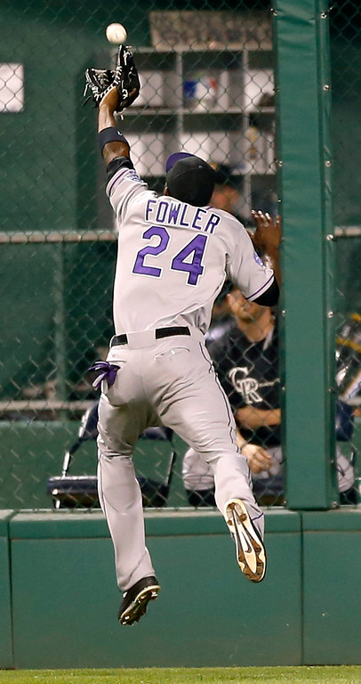 . Colorado Rockies center fielder Dexter Fowler just misses a fly ball by Pittsburgh Pirates\' Jose Tabata that went for a triple in the eighth inning of the baseball game on Saturday, Aug. 3, 2013, in Pittsburgh. (AP Photo/Keith Srakocic)