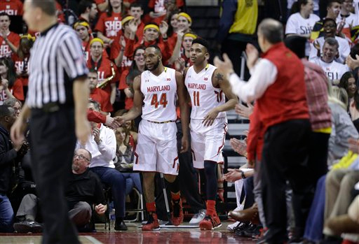 . Maryland guard/forwards Dez Wells, left, and Jared Nickens walk back onto the court after Wells ran through an escape lane during a play in the second half of an NCAA college basketball game against Michigan, Saturday, Feb. 28, 2015, in College Park, Md. (AP Photo/Patrick Semansky)