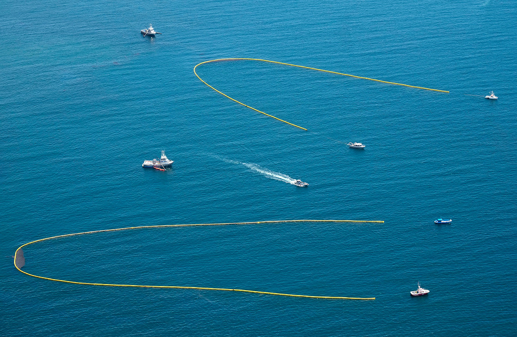 . Ships pulling booms collect oil from a spill near Refugio State Beach, north of Goleta, Calif., Wednesday, May 20, 2015. A broken onshore pipeline spewed oil down a storm drain and into the ocean for several hours Tuesday before it was shut off. (AP Photo/Michael A. Mariant)