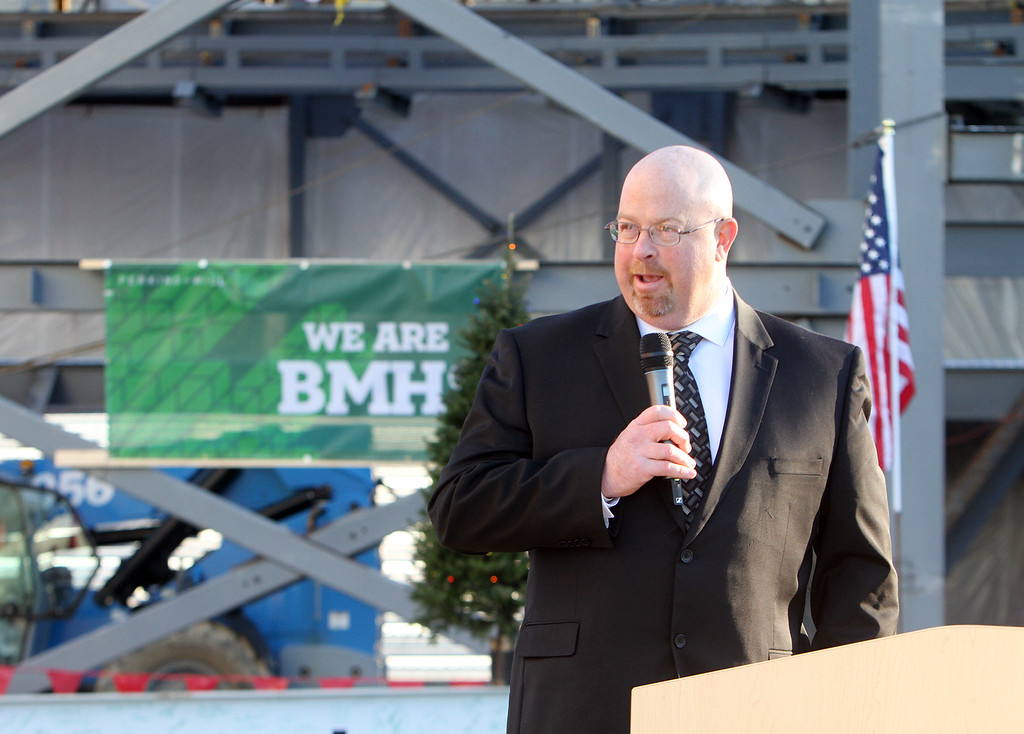 . High School Building Committee chair Kevin Heffernan speaks at the topping-off ceremony for the new Billerica Memorial High School.  (SUN/Julia Malakie)