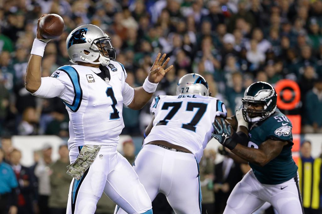 . Carolina Panthers\' Cam Newton passes during the first half of an NFL football game against the Philadelphia Eagles, Monday, Nov. 10, 2014, in Philadelphia. (AP Photo/Matt Rourke)
