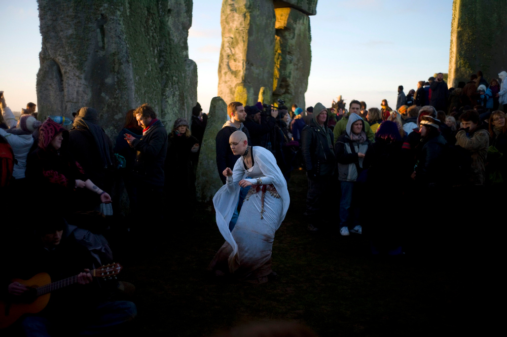 Description of . Revellers dance and chant incantations as the sun rises during the winter solstice at Stonehenge on Salisbury plain in southern England December 21, 2012. The winter solstice is the shortest day of the year, and the longest night of the year. REUTERS/Kieran Doherty