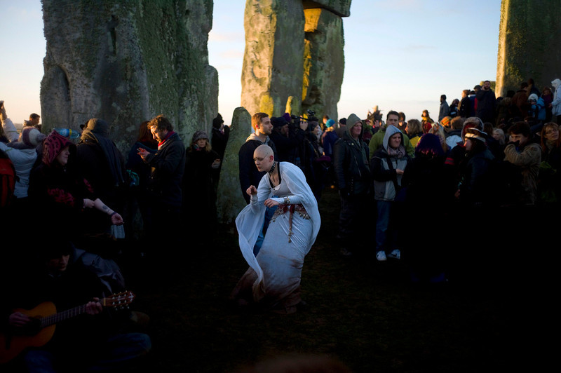 . Revellers dance and chant incantations as the sun rises during the winter solstice at Stonehenge on Salisbury plain in southern England December 21, 2012. The winter solstice is the shortest day of the year, and the longest night of the year. REUTERS/Kieran Doherty