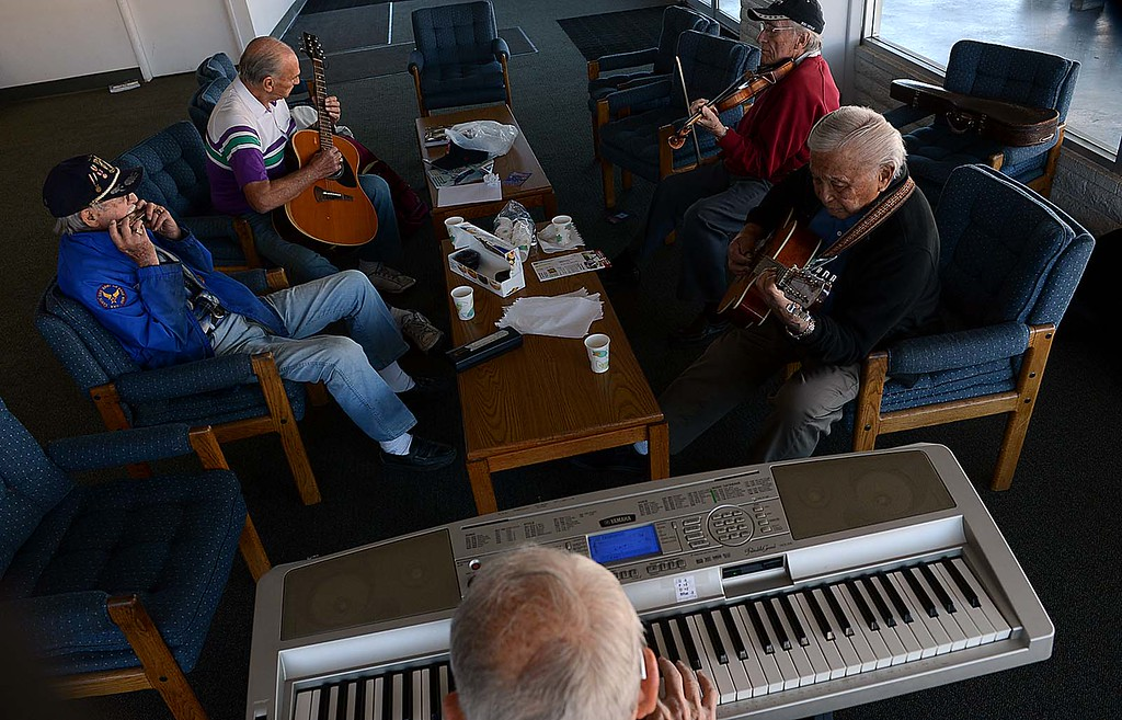 ". The Redlands Airport Philharmonic gather each Wednesday in the lobby of the Redlands Airport to share stories, coffee, donuts and ""Just to jam.\"" Says keyboardist Lew Lemon, 87. (Staff photo by Rick Sforza/Redlands Daily Facts)"