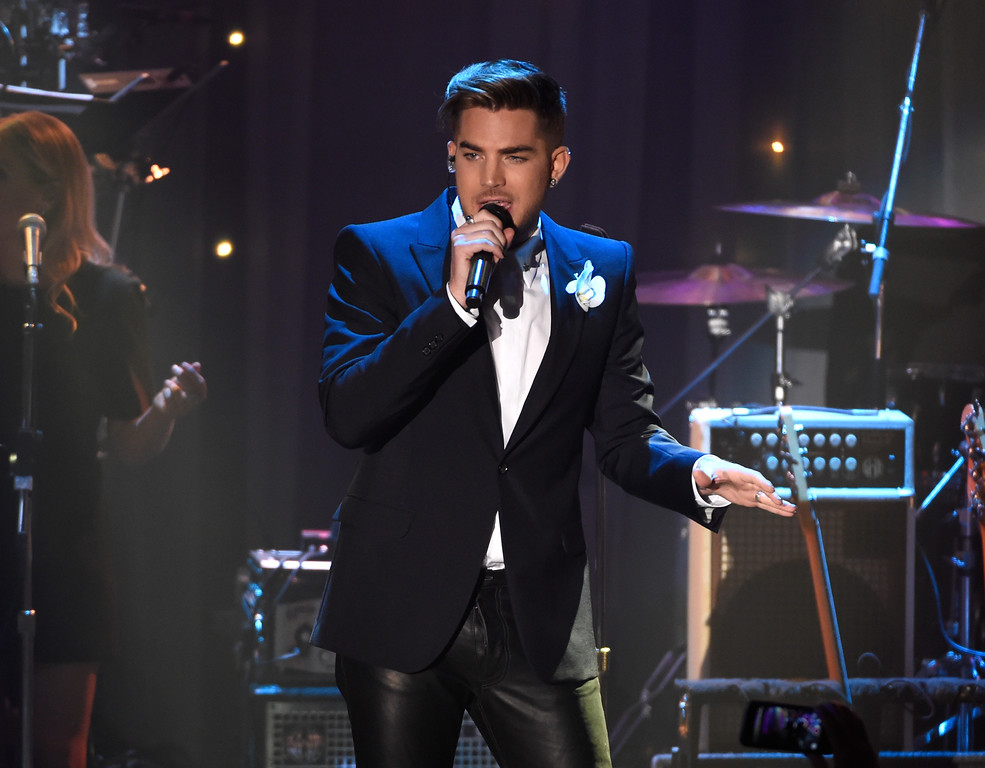 """. Adam Lambert performs at the 2016 Clive Davis Pre-Grammy Gala at the Beverly Hilton Hotel on Sunday, Feb. 14, 2016, in Beverly Hills, Calif. Queen + Adam Lambert will be at Quicken Loans Arena on July 21. For more information, visit <a href=\""""http://www.theqarena.com/events/detail/queen-170721\"""">theqarena.com/events/detail/queen-170721</a>. (Photo by Chris Pizzello/Invision/AP)"""