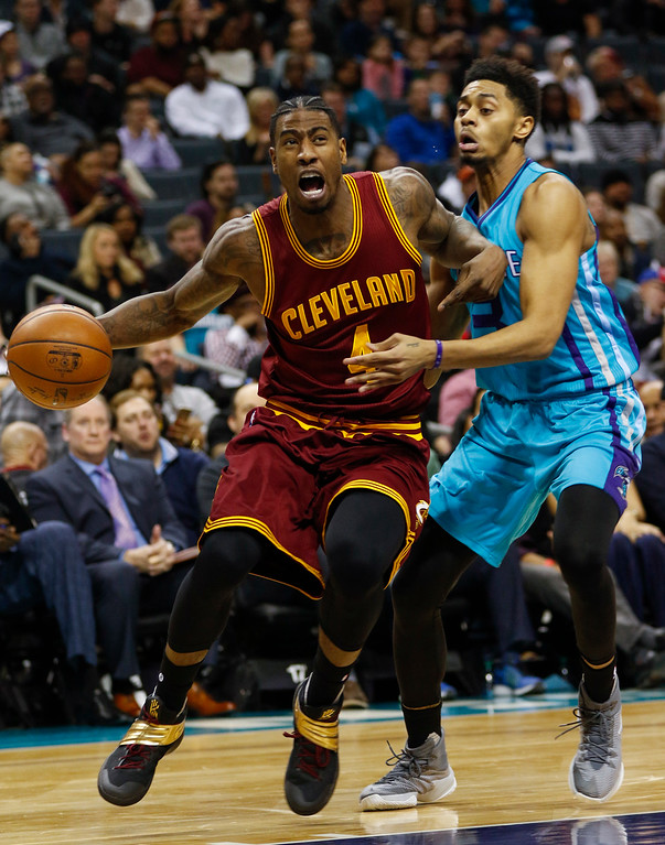 . Cleveland Cavaliers guard Iman Shumpert, left, drives around Charlotte Hornets guard Jeremy Lamb in the second half of an NBA basketball game in Charlotte, N.C., Saturday, Dec. 31, 2016. Cleveland won 121-109. (AP Photo/Nell Redmond)