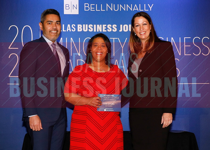 Erin Offord, Senior Director of Programs, Big Thought, (center) accepts her Minority Business Leader award from Chandhok, (left) and Mathes.