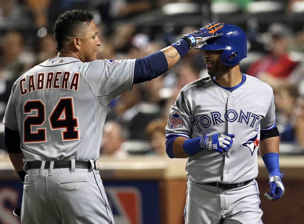 . American League\'s Miguel Cabrera (L), of the Detroit Tigers, celebrates scoring on a sacrifice fly by Jose Bautista (R) of the Toronto Blue Jays in the fourth inning during Major League Baseball\'s All-Star Game in New York, July 16, 2013.  REUTERS/Shannon Stapleton