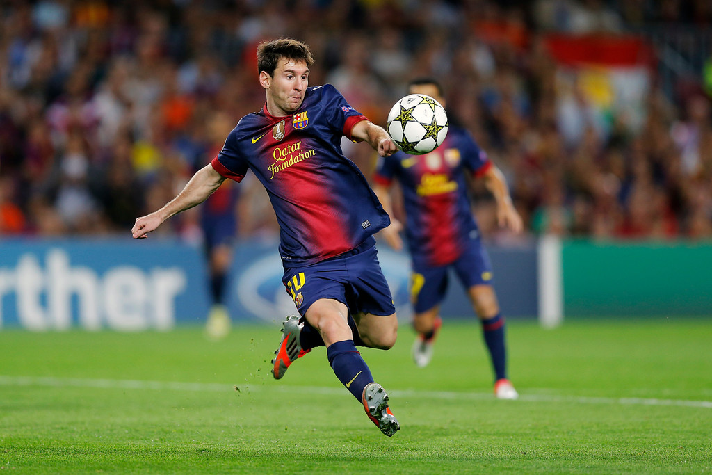 . FILE - The Sept. 19, 2012 file photo shows Barcelona\'s Lionel Messi from Argentina, eying the ball during a Champions League Group G soccer match against Spartak Moscow at the Camp Nou Stadium, in Barcelona. Lionel Messi won the  FIFA world\'s best footballer award for record 4th straight year on Monday, Jan 7, 2013. (AP Photo/Daniel Ochoa De Olza)