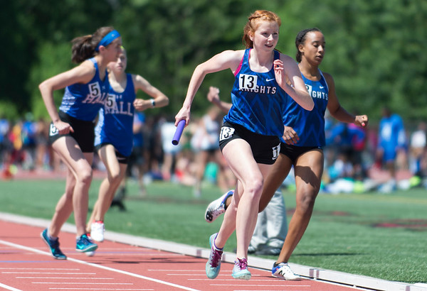 06/03/19 Wesley Bunnell | Staff The CIAC held their open track and field state open at Willow Brook Park on Monday afternoon. Southington girls competing during the 4x800 meter relay.