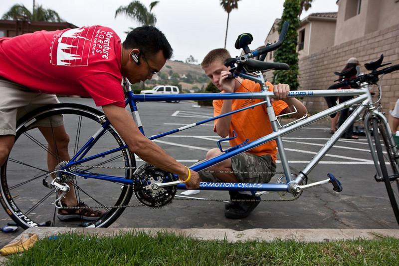 Roehl and Scott prep their bike in Oceanside.