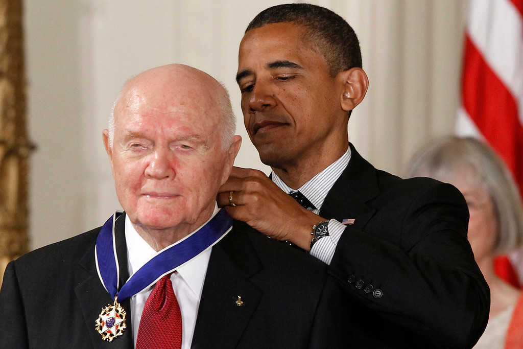 . President Barack Obama awards the Medal of Freedom to astronaut John Glenn during a ceremony in the East Room of the White House in Washington, Tuesday, May 29, 2012. The Medal of Freedom is the nation\'s highest civilian honor. It\'s presented to individuals who have made especially meritorious contributions to the national interests of the United States, to world peace or to other significant endeavors. (AP Photo/Charles Dharapak)