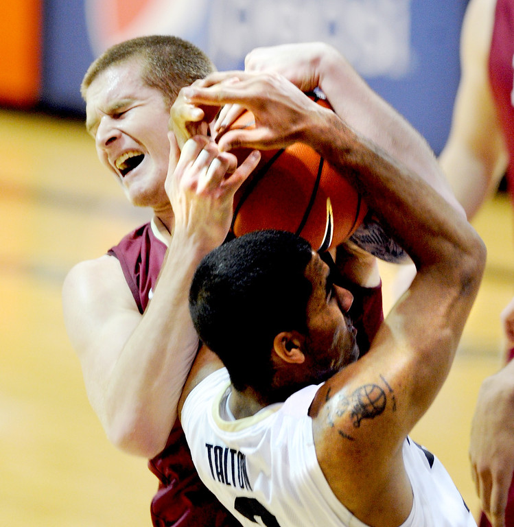 . Ryley Beaumont, top of Elon and Xavier Talton of CU, fight for a rebound    during the second half of the December 13, 2013 game in Boulder. (Cliff Grassmick/Boulder Daily Camera)