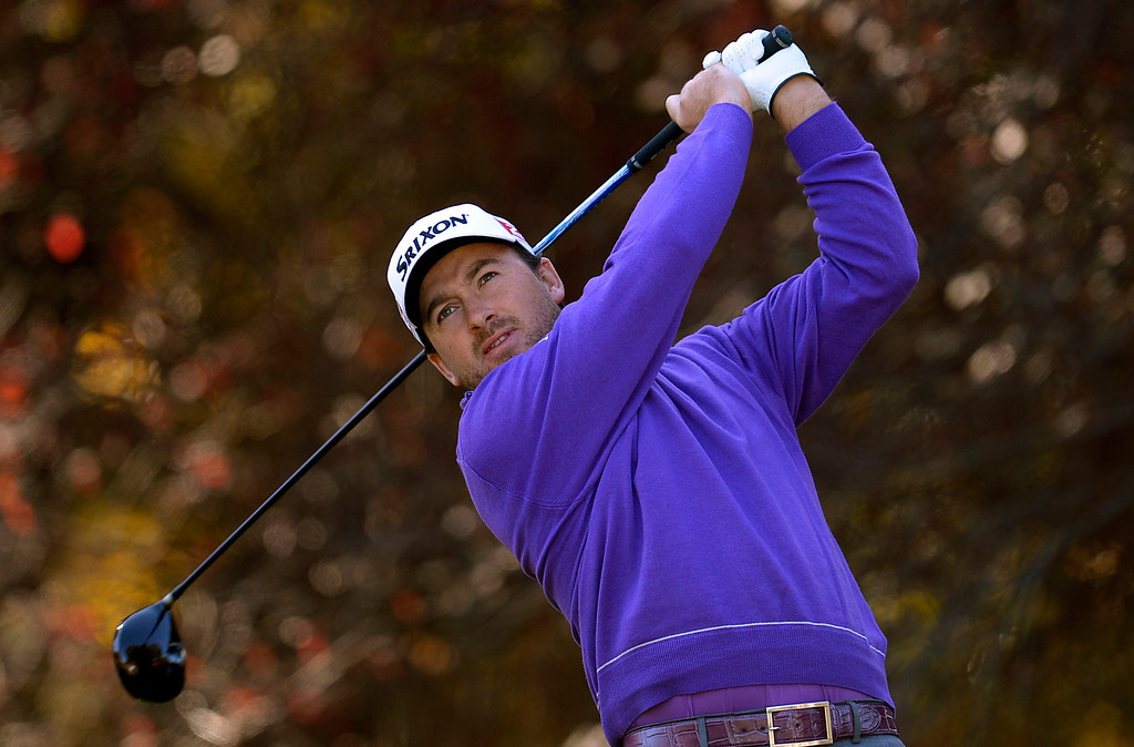 . Graeme McDowell hits a shot off the 2nd tee during the first-round of Tiger Woods\' Northwestern Mutual World Challenge at Sherwood Country Club in Thousand Oaks, CA Thursday December 5, 2013.(Andy Holzman/Los Angeles Daily News)